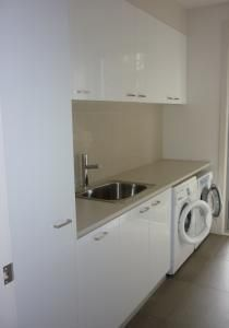 Image from http://home1.com.au/r/Romandini-Cabinets-3526/photos/laundry_storage_solutions.jpg.