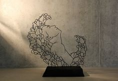 """""""By bending black wire into something of free-standing line drawings, I create sculptures that engage the viewer by involving them in their subtle changes."""""""