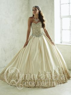 This gown presents a fully removable satin skirt, unveiling a short mini-skirt that perfectly complements the bodice, adorned with the same applique�_s as its larger counterpart. Features a lace-up back and beautifully beaded sweetheart neckline.