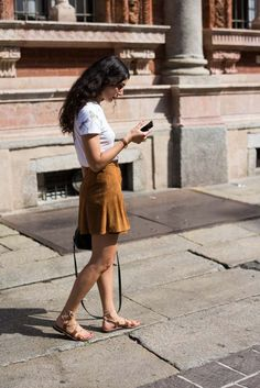 Womenswear Street Style by Ángel Robles. Fashion Photography from Milan Fashion Week. Suede mini skirt, white t-shirt and flat leather sandals after Missoni show, Milano.