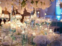 Glamorous Table Settings - all white wedding with a tinged of blue.