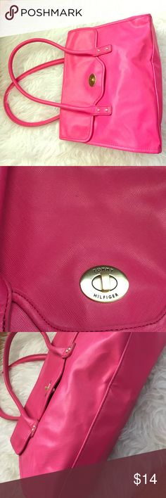 Tommy Hilfiger Purse  Adorable hot pink purse! I have never used it so the inside is in great condition! So roomy. Can hold a tablet and more!  The outside has a few spots from being in my closet but hardly noticeable! See pics! Awesome purse! Tommy Hilfiger Bags Shoulder Bags