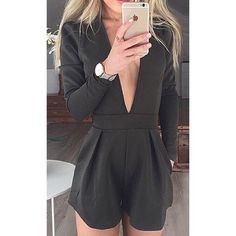 Low cut black romper FLASH SALE!! Cute low cut romper that's never been worn. Open to reasonable offers!! Dresses Mini
