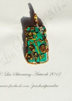 I checked out Gorgeous handpainted wire wrapped pendant on Lish, €18.75