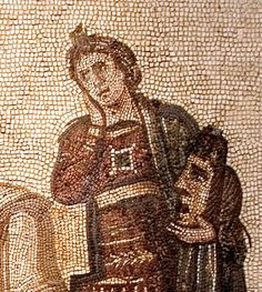 "Detail of mosaic depicting the great Latin poet, Virgil, holding a volume on which is written the Aenid. On either side stand the two muses: ""Clio"" (history) and ""Melpomene"" (tragedy). The mosaic, which dates from the 3rd Century A.D., was discovered in the Hadrumetum in Sousse, Tunisia and is now on display in the Bardo Museum in Tunis, Tunisia."