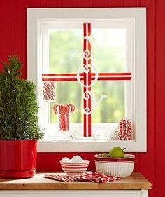 Make a good view even more special by wrapping it like a present. Details: http://www.midwestliving.com/holidays/christmas/4-ideas-for-winter-window-decorating/?page=1