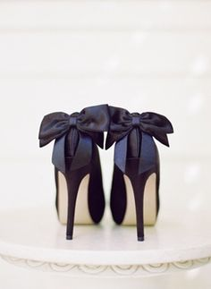 The bridal shoes shown here in a classic navy blue are so feminine with the big bows detailing the ankles.