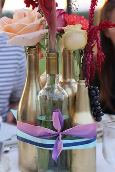spray empty wine/liquor bottles with metallic paint Hwa Young Brignone and Wells Wells Brown Feather Centerpieces, Bottle Centerpieces, Wedding Centerpieces, Wedding Decorations, Centerpiece Ideas, Fall Wedding, Diy Wedding, Wedding Reception, Dream Wedding