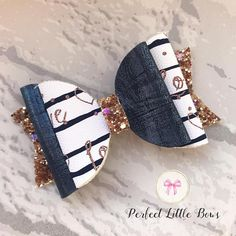 *design will differ slightly on each hair bow* This stunning handmade hair bow for girls is 3 Inches long. Perfect to finish off Girls hairstyles, this printed leatherette has been finished off with a navy blue leatherette and gold glitter fabric. Please note that all hair bows/ hair
