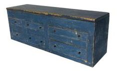 "RM332 19th century Pennslyvania store counter Apothecary / set of drawers with a storage compartment on top , circa 1850 with the original blue paint dovetailed drawers ,. measures 36"" long 10 1/2"" deep 13"" tall"