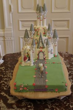Castle wedding cake with green lawn. Castle Wedding Cake, Wedding Cakes, Cupcake Cakes, Cupcakes, Cool Cake Designs, Disney Cakes, Green Lawn, Edible Art, Work Inspiration