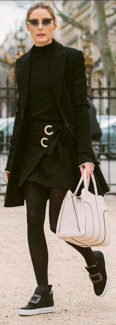 Who made Olivia Palermo's gray sunglasses, black coat, ring wrap skirt, beige handbag, and black crystal sneakers?