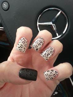 Animal Print Nails. I love the one matte nail!