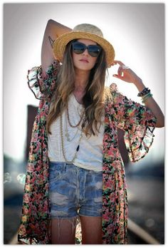 Ripped denim shorts, a plain tee and an oversized statement garment create this summertime bohemian look. Add some funky accessories to pull it all together.