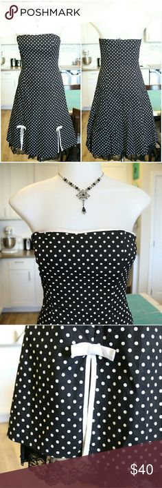 Black and White Polka Dot Strapless Dress This classic black with white polka dots dress will.nevwr go out of style. It features a peek at boo lace bottom with to slits up on the bottom front and cute white bows for embellishment. Zip up back closure.  Material: 97% Cotton 3%Spandex Made in USA   Bundle and save 10% Free gift with purchase over $20 I.N. San Francisco  Dresses Strapless