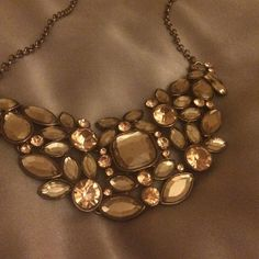 Necklace One stunning necklace.... Elegant and classy different shades of bronze   Very sparkly Givenchy Jewelry Necklaces