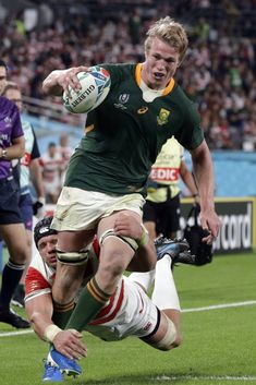 South Africa's Pieter-Steph du Toit is tackled during the Rugby World Cup quarterfinal match at Tokyo Stadium between Japan and South Africa in Tokyo, Japan, Sunday, Oct. (AP Photo/Mark Cup final: Some players to watch in England vs Boks Women's Cycling Jersey, Cycling Jerseys, Cycling Quotes, Cycling Art, Manu Tuilagi, World Cup Games, Super Rugby, Rugby Men, Soccer League