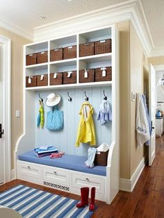 """Nice mudroom BUT this explains the idea of a """"transfer basket"""". You put it by the door, everything goes in that needs to go out the door with you tomorrow, school work, bills, etc. Haul basket to car in the morning, bring it back when your done."""