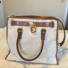 MK large handbag Cream and camel canvas MK large handbag with gold hardwareLIKE NEW. No flaws and comes with dust bag. Michael Kors Bags Shoulder Bags