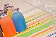 """DIY refrigerator shelf liners from a tablecloth. Great idea and if you're """"going green"""" you'll love that they can be washed and reused."""