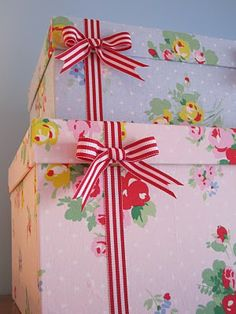 "Turn those shoe boxes into pretty storage! Here's a ""How to..."" on covering shoe boxes with fabric."