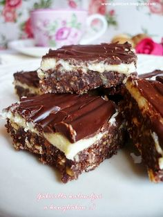 """Date and Almond fudge with sesame coconut.These sticky, rich, healthy vegan """"fudge"""" squares take just minutes to make in a food processor. Coconut Recipes, Fudge Recipes, Wine Recipes, Gourmet Recipes, Snack Recipes, Dessert Recipes, Snacks Ideas, Candy Recipes, Brunch Recipes"""