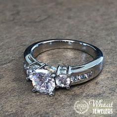 7c56c214a438 14K white gold 3 stone round diamond engagement ring with round channel set  accent diamonds.