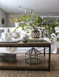 Coffee table styling - love height the branches add eclecticallyvintage.com