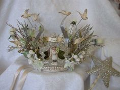 crown composed of angel figurine, birds, twigs