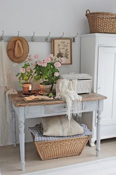 Shabby Chic Interior: Antique table, soft pastel walls, wood flooring.