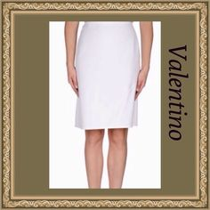 Valentino Skirt Valentino White knee length skirt. Composition: 75% Cotton, 25% Viscose Details: jacquard, plain weave, solid color, no appliqués, no pockets, side closure, zip closure, unlined, a-line style.TRADESPAYPAL Valentino Skirts Midi