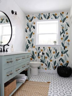 Beautiful colorful bathroom renovation feauturing natural stone tiles, modern vainity and hardware. Lots of bathroom makeover ideas to use in your home.
