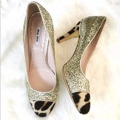 """Miu Miu Gold Glitter & Leopard Toe Heels Pumps 38 ❌NO TRADES❌  - Miu Miu Gold Glitter & Leopard Toe Heels Pumps Sz 38  - Gold Glittered leather with leopard spot print calf hair accents  - Round, calf hair cap toe. Approx 4 1/3"""" heel.  - Made in Italy. Great used condition. Wear on bottoms & glitter rubbing off on back of heels. See pics. Miu Miu Shoes Heels"""