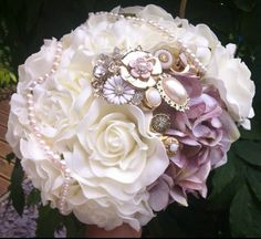 Ivory with dusky pink and a cluster of gold brooches :)