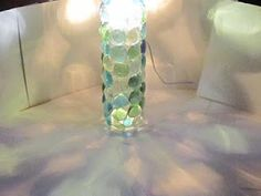 Lamp made from a glass Voss water bottle and glass gems from the dollar tree!