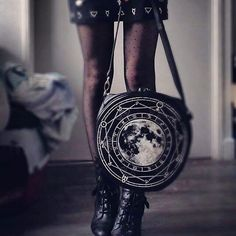 Unique and mysterious design Full Moon Night Gypsy Gothic Round Crossbody bag made of high quality solid, black faux leather. On front there is a huge, detailed print of full moon, geometry and alchem