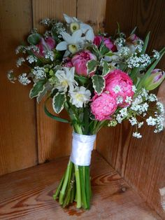 Spring flower girl posy with cow parsley, ranunculus and narcissus