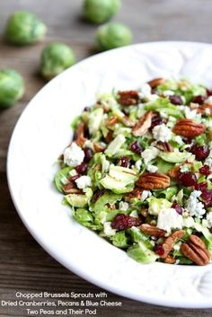 Chopped Brussels Sprouts with Dried Cranberries, Pecans, and Blue Cheese Recipe on twopeasandtheirpod.com