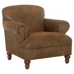 Bring stately style to your living room seating group or home office decor with this handsome wood-framed arm chair, showcasing nailhead trim and timeless tu...