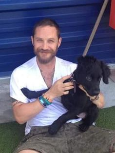 Tom Hardy and the very cute Travis at Battersea Dogs Home today.""