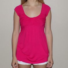 Fuchsia Empire Waist Cap Sleeve Top Ruched and gathered at the chest to turn what would be a basic tee into a cute alternative. Boat neck, cap sleeves. Fitted on top and loose on bottom. Great for spring and summer! Like new! Purchased from Nordstrom. Soprano Tops Blouses
