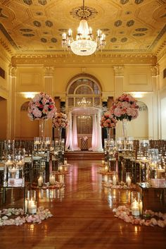 Photography: Nadia D Photography; The candles make this ballroom ceremony so chic and romantic.