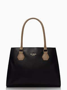 crafted of soft, smooth leather and cast with a contrasting hue at the handle, this lovely handbag is truly at home when on the town. named for a bustling new york city byway, we think it's the epitome of classic cosmopolitan charm and the triple compartment inside is a bonus for the highly-organized gal.