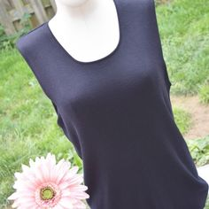 NWOT Banana Republic silk sleeveless sweater, XL Gorgeous, black Banana Republic sleeveless, silk sweater. This is a wardrobe staple and can be worn during the warmer months, but is also light enough for layering in the cooler months. The material is soft and the scoop neck is very flattering. This has never been worn and is in perfect condition. Size XL. Banana Republic Sweaters Crew & Scoop Necks