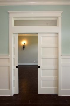Pocket doors w/ transom windows Light turquoise walls are especially appropriate paired with architectural gems like a transom window, five-panel pocket doors and Arts and Crafts interior trim. Interior Trim, Interior Barn Doors, Interior Design, Interior Pocket Doors, Interior Door Styles, Double Doors Interior, Interior Colors, Farmhouse Interior, Painted Interior Doors