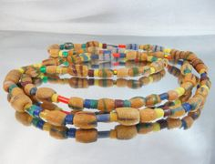 This antique African Trade Beads necklace is incredible!   This extra long necklace is filled with  Ashanti powder glass beads from Ghana which have been made by African tr... #etsy #vintage #antiques #shopping #jewelry #jewellery #easter #spring