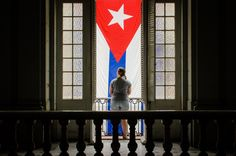 Cuban flag hanging proudly off the balcony of the Museo de la Revolución (Museum of the Revolution) in Havana, Cuba. #Havana #Cuba #Travel #TravelPhotography #Photography #Flag #Cuban #Revolution #Museum
