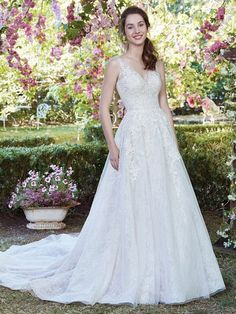 Rebecca Ingram - ruth, This romantic A-line wedding dress features layers of tulle and allover lace. Beaded lace appliqués dance over the bodice, complete with illusion straps, a scoop back trimmed in illusion, and V-neck. Finished with covered buttons and zipper closure.
