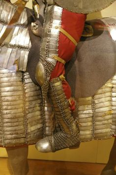 Ottoman Empire mail-and-plate dizcek (cuisse or knee and thigh armor) and kolçak (greaves or shin armor) as worn by fully armored cavalryman (sipahi) in conjunction with migfer (helmet), krug (chest armor), zirah (mail shirt), kolluk/bazu band (vambrace/arm guards).