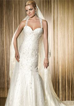 Besides the fact that this girl looks like a cross between Leann Rimes and Barbie, the dress is kind of pretty.